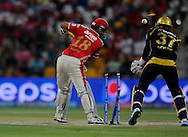 Virender Sehwag of the Kings X1 Punjab gets bowled out by Piyush Chawla of the Kolkata Knight Riders during match 15 of the Pepsi Indian Premier League 2014 Season between The Kings XI Punjab and the Kolkata Knight Riders held at the Sheikh Zayed Stadium, Abu Dhabi, United Arab Emirates on the 26th April 2014<br /> <br /> Photo by Pal Pillai / IPL / SPORTZPICS
