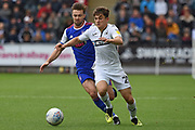 Swansea City midfielder Daniel James (20) takes on Ipswich Town midfielder Gwion Edwards (7) during the EFL Sky Bet Championship match between Swansea City and Ipswich Town at the Liberty Stadium, Swansea, Wales on 6 October 2018.
