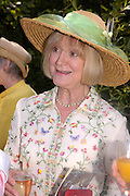 Joanna Fox. Marriage of Emilia Fox to Jared Harris. St. Michael's and All Angels. Steeple. Nr. Wareham. Dorset. 16 July 2005. ONE TIME USE ONLY - DO NOT ARCHIVE  © Copyright Photograph by Dafydd Jones 66 Stockwell Park Rd. London SW9 0DA Tel 020 7733 0108 www.dafjones.com