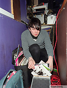 Ciaran, DJ at The Junk Club, looking through his records, Southend, UK 2006