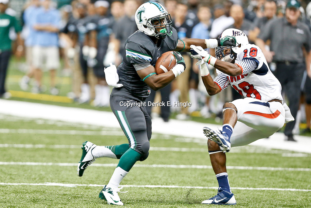 Sep 7, 2013; New Orleans, LA, USA; Tulane Green Wave running back Josh Rounds (25) stiff arms South Alabama Jaguars safety Terrell Brigham (18) during the first quarter of a game at the Mercedes-Benz Superdome. Mandatory Credit: Derick E. Hingle-USA TODAY Sports