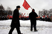 Communist supporters, carrying red flags, pour out on the street in Moscow to demonstrate.