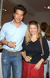 SOPHIA SWIRE and ANDREAS LIM at a party to launch the Acqualuna jewellery exhibition at Allegra Hicks, 28 Cadogan Place, London on 22nd June 2005.<br />