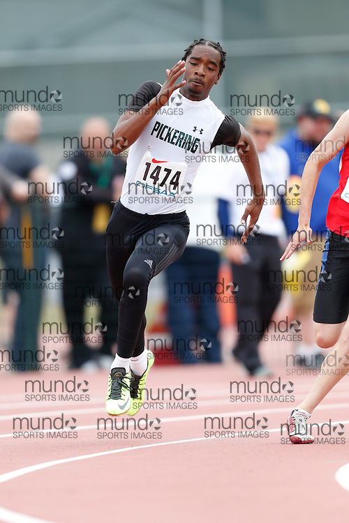 Keyshaun Cumberbatch of Pickering HS - Ajax competes in the 200m heats at the 2013 OFSAA Track and Field Championship in Oshawa Ontario, Saturday,  June 8, 2013.<br /> Mundo Sport Images/ Geoff Robins