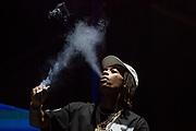 Rap iccon Wiz Kalifa entertains the crowd Saturday night at Music Midtown.