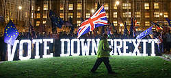 © Licensed to London News Pictures. 10/12/2018. London, UK. Anti-Brexit protesters gather outside Parliament as Prime Minister Theresa May postpones the parliamentary vote on her Brexit deal. Photo credit: Rob Pinney/LNP