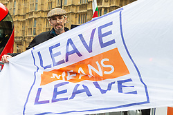 Anti-EU protester Shaun, 51 from Mid Wales displays his Leave Means Leave banner outside the Houses of Parliament in London. London, January 14 2019.