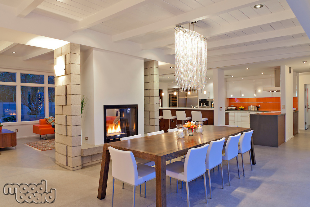 Contemporary chandelier in modern dining room of luxurious villa