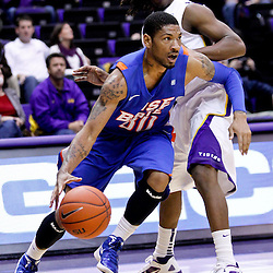 December 10, 2011; Baton Rouge, LA; Boise State Broncos guard Westly Perryman (30) drives past LSU Tigers guard Anthony Hickey (1) during the second half of a game at the Pete Maravich Assembly Center. LSU defeated Bosie State 64-45. Mandatory Credit: Derick E. Hingle-US PRESSWIRE