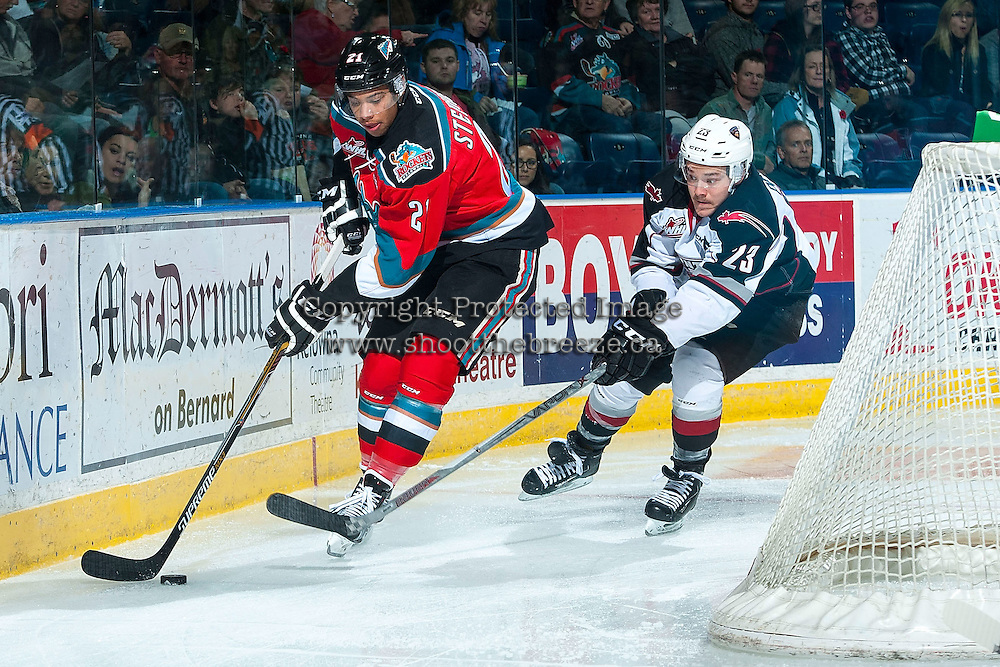 KELOWNA, CANADA - NOVEMBER 11: Elliott Peterson #23 of Vancouver Giants back checks Devante Stephens #21 of Kelowna Rockets behind the net on November 11, 2015 at Prospera Place in Kelowna, British Columbia, Canada.  (Photo by Marissa Baecker/ShoottheBreeze)  *** Local Caption *** Elliott Peterson; Devante Stephens;