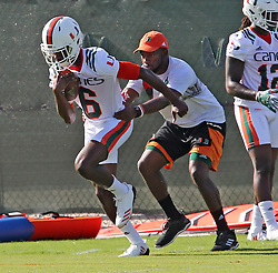 August 1, 2017 - Coral Gables, FL, USA - UM's DB Jhavonte Dean (6) runs a drill with a coach at the University of Miami's first day of football practice for the 2017 season on Tuesday, Aug. 1, 2017 in Miami, Fla. (Credit Image: © Charles Trainor Jr/TNS via ZUMA Wire)