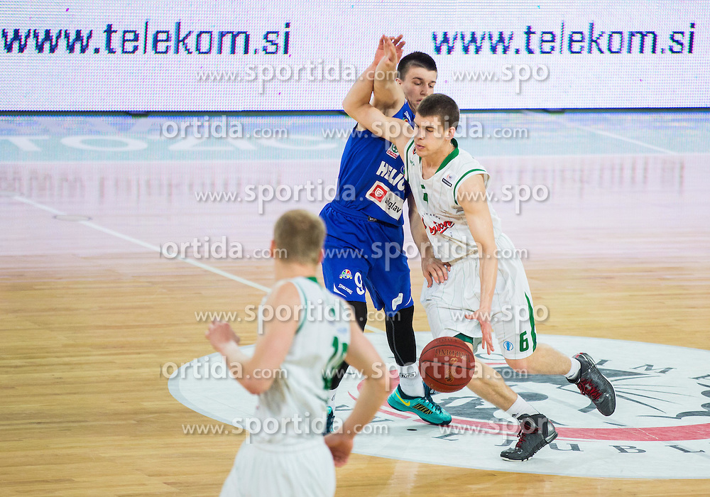 Matic Rebec of Helios vs Paolo Marinelli of Union Olimpija during basketball match between KK Union Olimpija and KK Helios Domzale in 9th Round of Telemach Champions League 2013/14, on April 25, 2014 in Arena Stozice, Ljubljana, Slovenia. Photo by Vid Ponikvar / Sportida