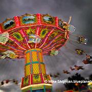 Swing ride at night with pending storm, Idaho.Ada County.Boise.Western Idaho Fair