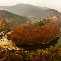 Amazing river meander in autumn forest