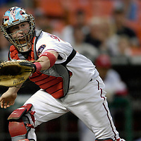 16 May 2007:   Washington Nationals catcher Brian Schneider (23) goes up the line to catch an off target throw in the 4th inning on an RBI single by Atlanta Braves first baseman Scott Thorman that scored right fielder Jeff Francoeur.  The Nationals defeated the Braves 6-4 at RFK Stadium in Washington, D.C.  ****For Editorial Use Only****