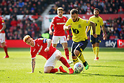 Blackburn Rovers forward Adam Armstrong (7)  gets past the challenge of Nottingham Forest midfielder Jack Colback (6)   during the EFL Sky Bet Championship match between Nottingham Forest and Blackburn Rovers at the City Ground, Nottingham, England on 13 April 2019.