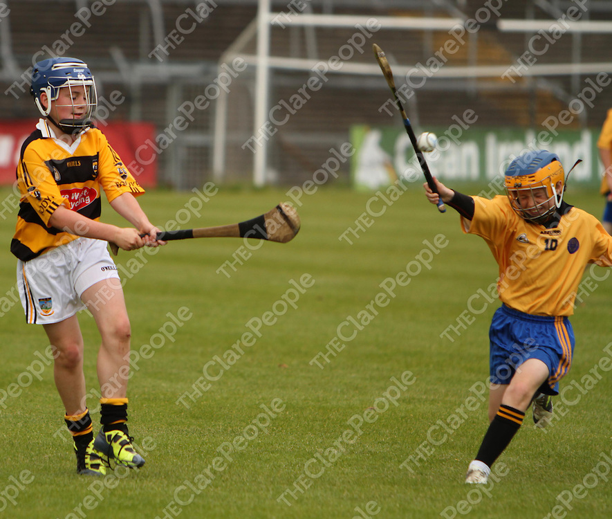 Tuamgraney/Bodyke's Jack Minogue get his shot through Clonmoney's Eanna Crimmins at the Cumann na mBunscol hurling and camogie finals in Cusack Part on Wednesday.<br /> Photograph by Press 22