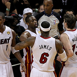 Jun 21, 2012; Miami, FL, USA; Miami Heat power forward Chris Bosh (1), shooting guard Dwyane Wade (3), small forward LeBron James (6) and Miami Heat shooting guard Mike Miller (13) react during the third quarter in game five in the 2012 NBA Finals against the Oklahoma City Thunder at the American Airlines Arena. Mandatory Credit: Derick E. Hingle-US PRESSWIRE
