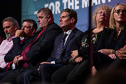 © Licensed to London News Pictures. 26/09/2018. Liverpool, UK. Shadow Brexit Secretary Keir Starmer MP (centre) on stage during Jeremy Corbyn's closing speech at the Labour Party Conference. Photo credit: Rob Pinney/LNP