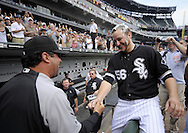 CHICAGO - JULY 23:  Mark Buehrle #56 of the Chicago White Sox high fives manager Ozzie Guillen #13 after recording the 18th perfect game in major league history against the Tampa Bay Rays on June 23, 2009 at U.S. Cellular Field in Chicago, Illinois.  The White Sox defeated the Rays 5-0. (Photo by Ron Vesely)