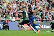 Tom Elliott forward for AFC Wimbledon (9) skips past Plymouth Argyle defender Peter Hartley (6) during the Sky Bet League 2 play off final match between AFC Wimbledon and Plymouth Argyle at Wembley Stadium, London, England on 30 May 2016. Photo by Stuart Butcher.