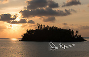 Sunset over a small island off the coast of Banda Neira, one of the Spice islands of Indonesia.