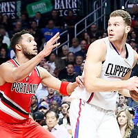 12 December 2016: LA Clippers forward Blake Griffin (32) looks to pass the ball over Portland Trail Blazers guard Evan Turner (1) during the LA Clippers 121-120 victory over the Portland Trail Blazers, at the Staples Center, Los Angeles, California, USA.