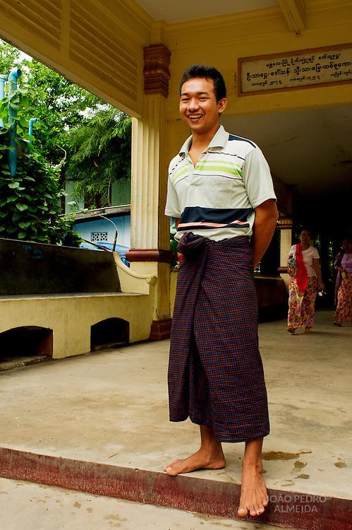Man an entrance of small Mandalay pagoda