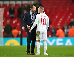 File photo dated 15-11-2018 of England manager Gareth Southgate shakes hands with Wayne Rooney.
