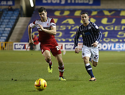Millwall's Scott McDonald and Middlesbrough's Daniel Sanchez Ayala chase down the ball - Photo mandatory by-line: Robin White/JMP - Tel: Mobile: 07966 386802 21/12/2013 - SPORT - FOOTBALL - The Den - Millwall - Millwall v Middlesbrough - Sky Bet Championship