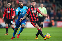 Steve Cook of Bournemouth battles for the ball with Alexandre Lacazette of Arsenal - Mandatory by-line: Alex James/JMP - 14/01/2018 - FOOTBALL - Vitality Stadium - Bournemouth, England - Bournemouth v Arsenal - Premier League