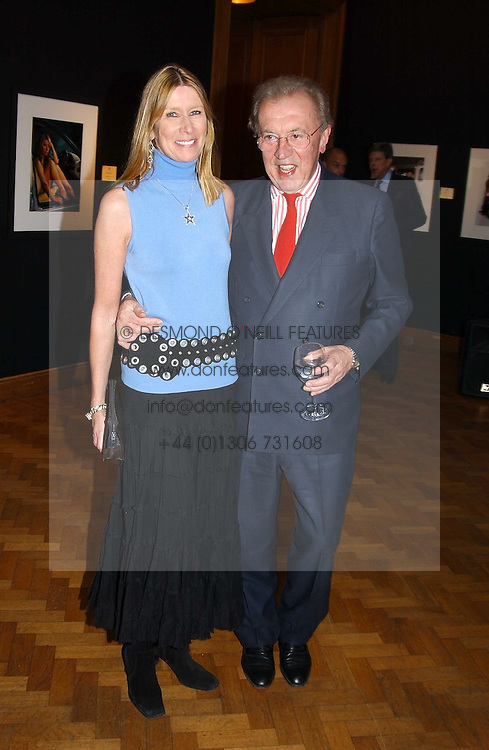 SIR DAVID & LADY CARINA FROST at '4 Inches' a project 'For Women about Women By Women' - A photographic Auction in aid of the Elton John Aids Foundation hosted by Tamara Mellon President of Jimmy Choo and Arnaud Bamberger MD of Cartier UK at Christie's, 8 King Street, London W1 on 25th May 2005.<br /><br />NON EXCLUSIVE - WORLD RIGHTS