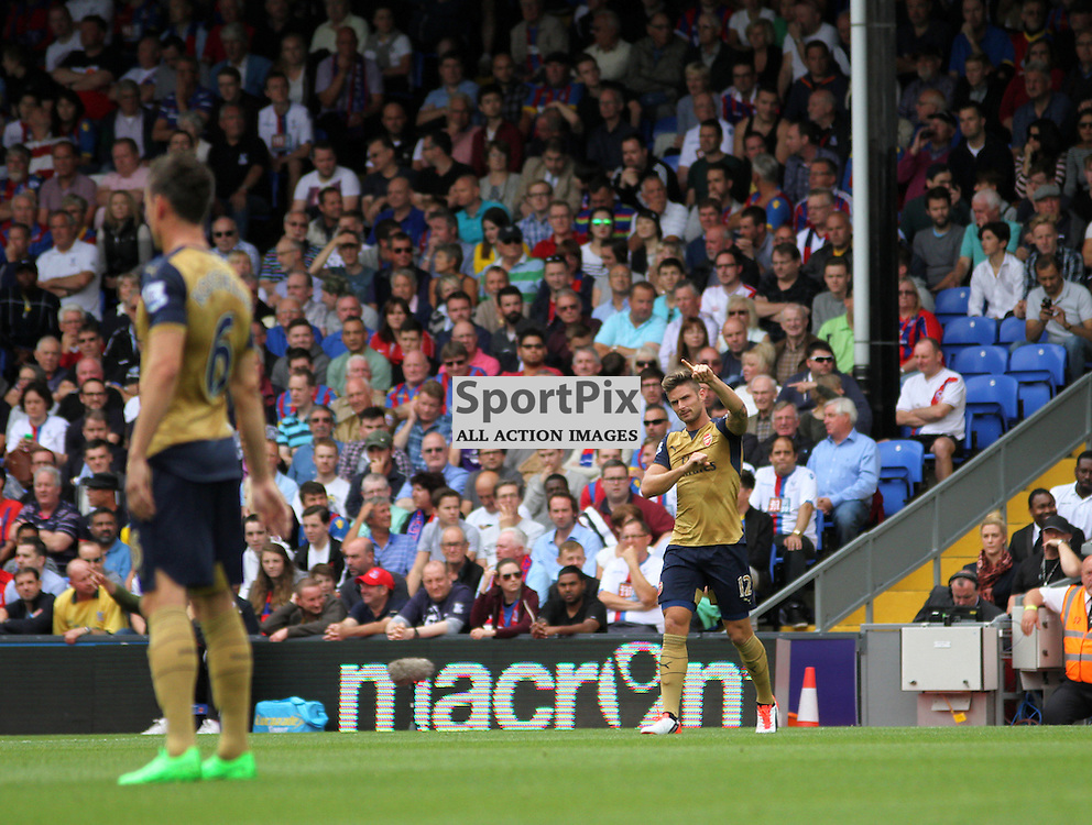 Olivier Giroud points to the away fans in celebration after his goal During Crystal Palace vs Arsenal on Sunday the 16th August 2015.