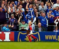 Photo: Alan Crowhurst.<br />Portsmouth v West Ham United. The Barclays Premiership. 14/10/2006. Kanu (L) celebrates with Matthew Taylor after scoring the opener.