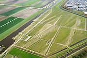 Nederland, Noord-Holland, Hoofddorp, 09-04-2014; Landartpark Buitenschot, de ribbels dienen tevens om geluidsoverlast te verminderen. Bureau H+N+S , kunstenaar Paul de Kort <br /> Landartpark, the ridges also serve to reduce noise.<br /> luchtfoto (toeslag op standard tarieven);<br /> aerial photo (additional fee required);<br /> copyright foto/photo Siebe Swart