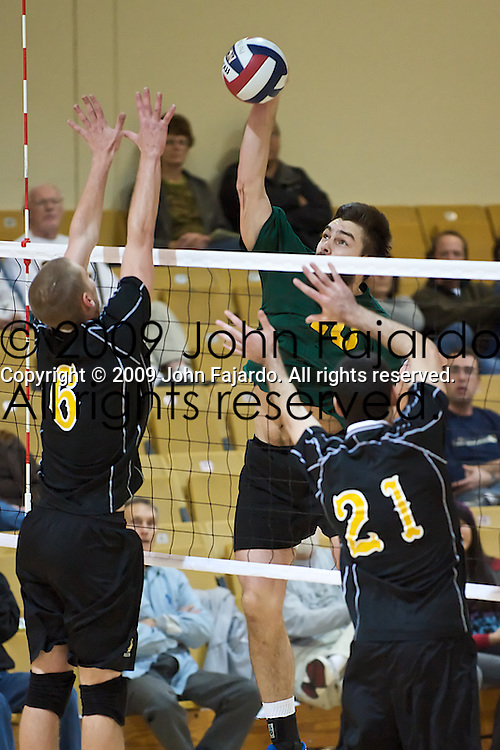 02Jan09 Long Beach, CA-  University of Alberta Outside Hitter Joel Schmuland catches the 49er block off guard to recocord one of his seventeen kills on the night.  The Golden Bears defeated the 49ers in three straight sets.