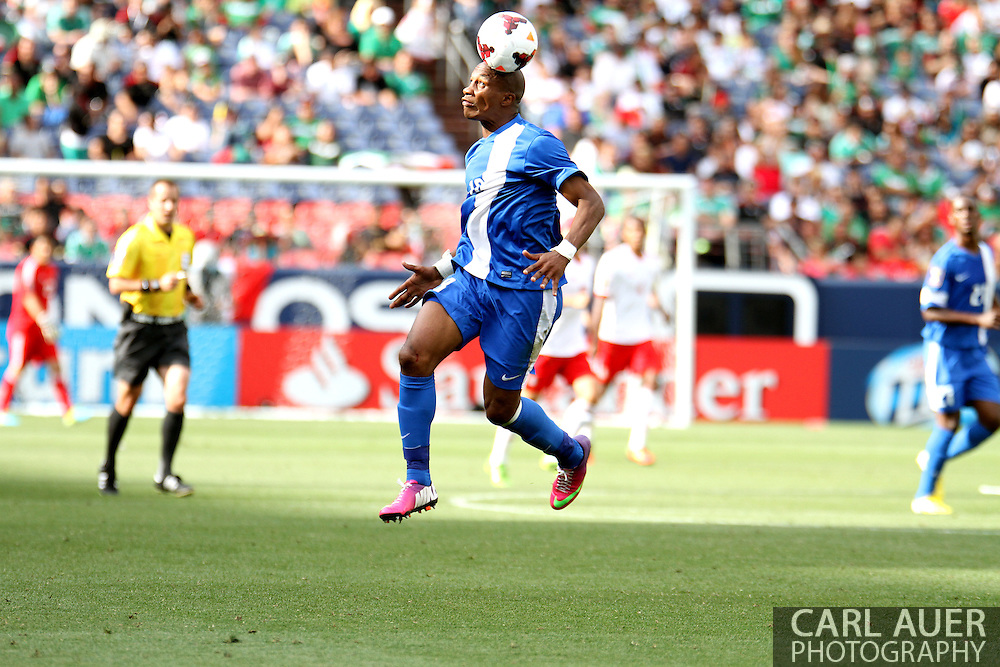 July 14 2013:  Martinique Defender Gregory Arnolin (18) heads the ball in the second half of the CONCACAF Gold Cup soccer match between Martinique and Mexico at Sports Authority Field in Denver, CO. USA.