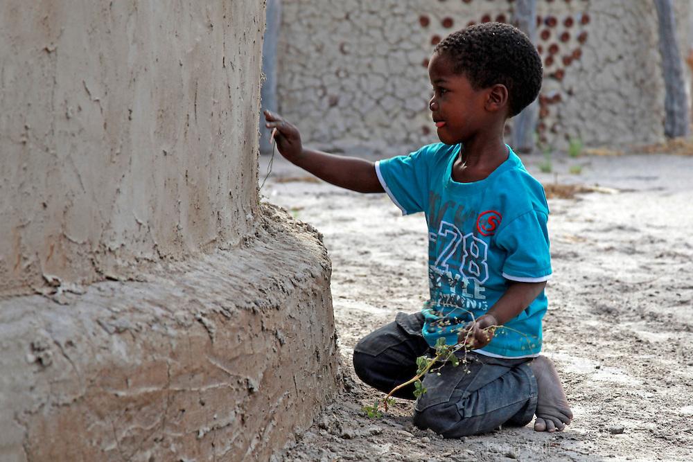 Africa, Botswana, Okavango Delta. Young boy growing up in a village in the Okavango Delta.