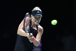 October 24, 2018 - Singapore, Singapore - ANGELIQUE KERBER of Germany returns a shot during her match against Naomi Osaka on day 4 of the WTA Finals at the Singapore Indoor Stadium. Kerber won 6:4, 5:7, 6:4. (Credit Image: © Paul Miller/ZUMA Wire)