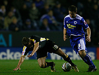 Photo: Steve Bond.<br />Leicester City v Cardiff City. Coca Cola Championship. 26/11/2007. Stephen McPhail (L) tumbles under a challange from James Wesolowski (R)