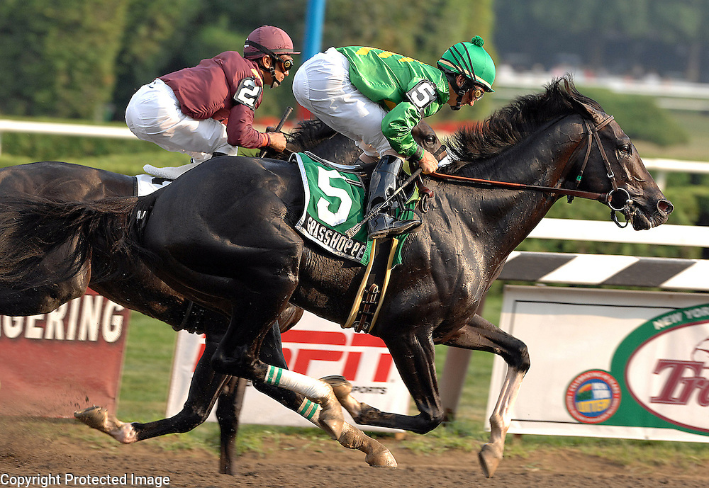 Grasshopper takes an early lead in the Travers Stakes.