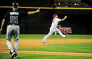 May 19 2011; Phoenix, AZ, USA; Arizona Diamondbacks third basemen Ryan Roberts throws the ball to first base to get the force out against the Atlanta Braves at Chase Field. The Diamondbacks defeated the Braves 2-1. Mandatory Credit: Jennifer Stewart-US PRESSWIRE.