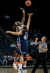 Virginia center Aisha Mohammed (33) out leaps Rhode Island center Whitney Hollis (41) for the opening tip off.  The Virginia Cavaliers women's basketball team defeated the Rhode Island Rams 89-53 at the John Paul Jones Arena in Charlottesville, VA on January 9, 2008.