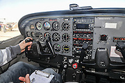 Pilot perform a preflight check on a cessna skyhawk inside the cockpit