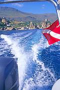 Motor boat white water wake Scopello, Sicily, Italy