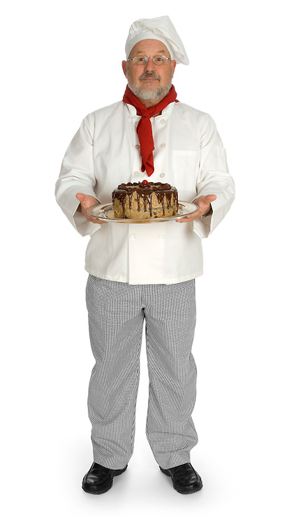 Gourmet chef holding a German chocolate cake against a white background