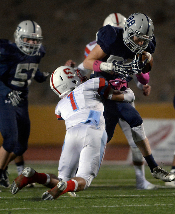 gbs102016q/SPORTS -- La Cueva's Tristan Roswold, catches a pass is tackled by Sandia's Jacob Archibeque, 1, during the game at Wilson Stadium on Thursday, October 20, 2016.(Greg Sorber/Albuquerque Journal)