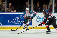 KELOWNA, CANADA - JANUARY 4: Josh Curtis #10 of the Prince George Cougars stick checks Lassi Thomson #2 of the Kelowna Rockets as he skates with the puck on January 4, 2019 at Prospera Place in Kelowna, British Columbia, Canada.  (Photo by Marissa Baecker/Shoot the Breeze)