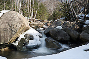 Giant Mountain Wilderness, Adirondacks, NY.<br /> <br /> Standing on a snowbridge below this little waterfall, I was arguing  with myself about the chances of collapse, and thinking that it always seems we want a shot from the most dangerous and unstable place we can find.  Towards the end of March, streams were beginning to emerge from their snow blanket, and the days became a bit tougher for hiking as temps rose and the snow turned mushy.