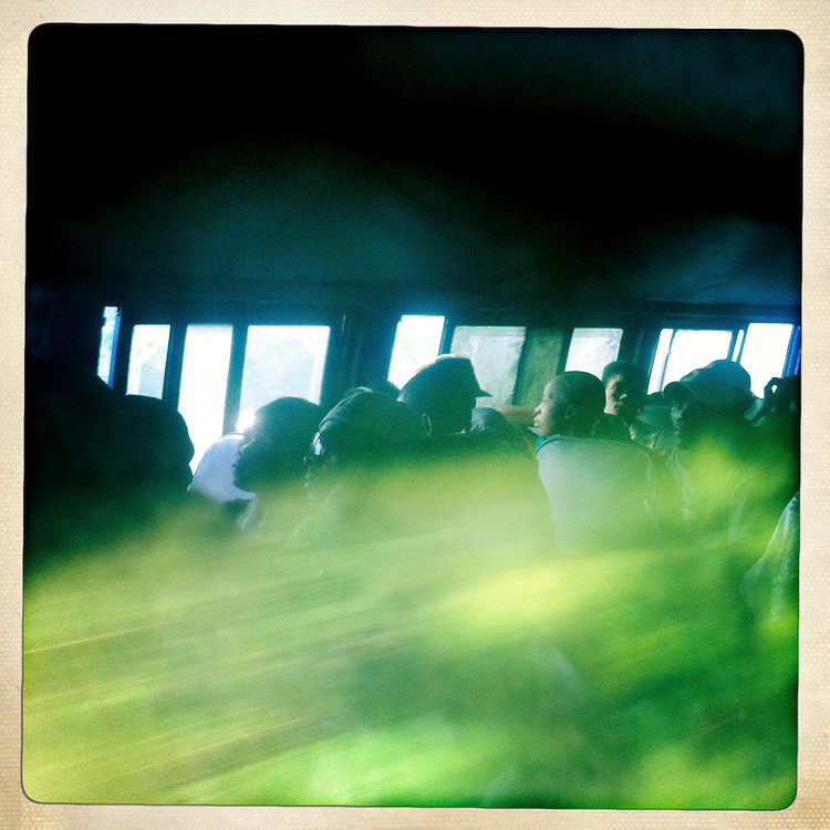 A bus full of passengers drives toward Petionville on Tuesday, April 3, 2012 in Kenscoff, Haiti.